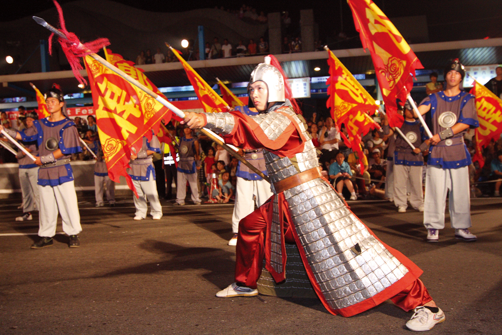 Kuo clansmen dress in ancient warriors uniforms and march in the evening parade.