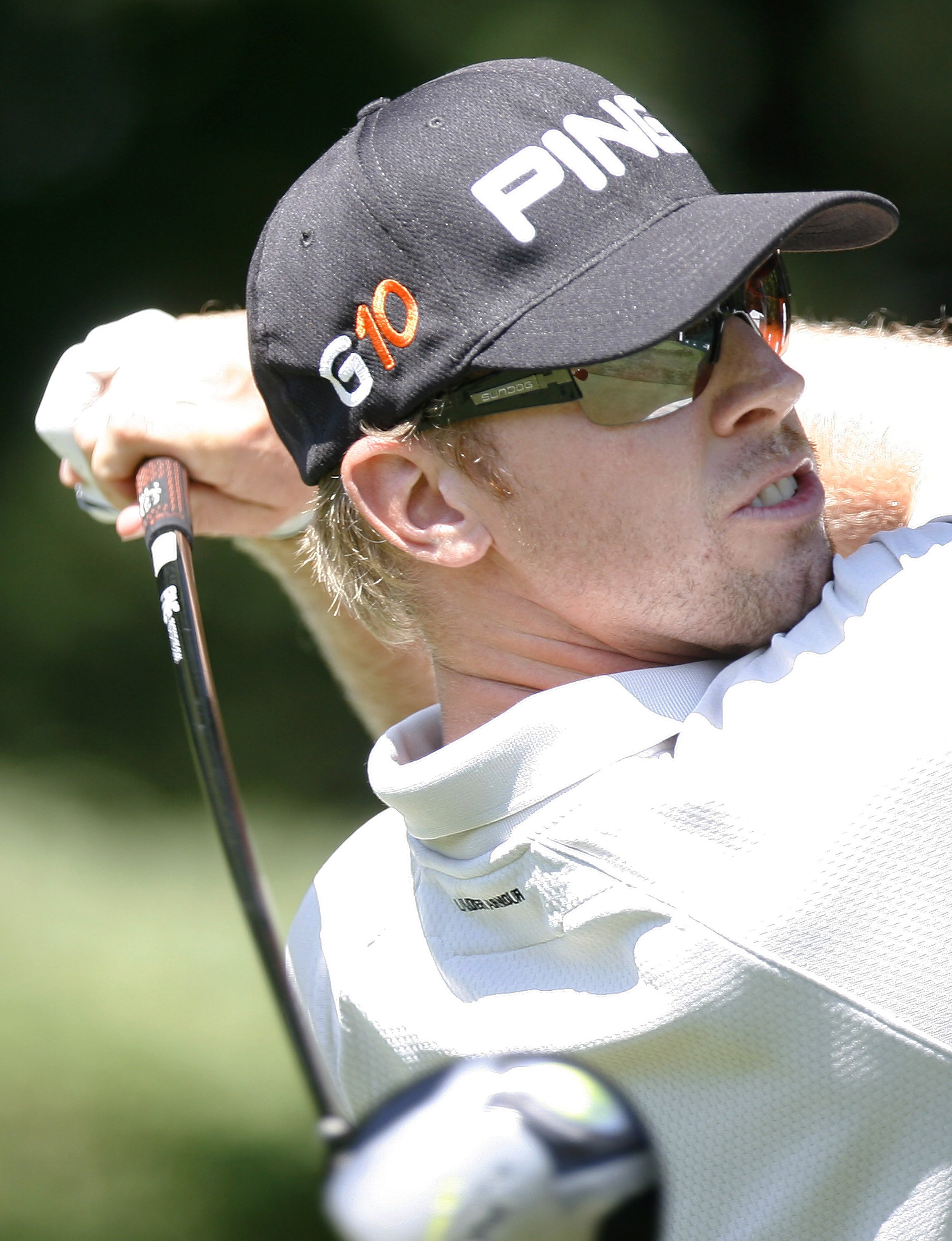 Golfer Hunter Mahan of the U.S. tees off on the 17th hole at the Ridgewood Country Club during the first round of the PGA Tour Barclays tournament in ...