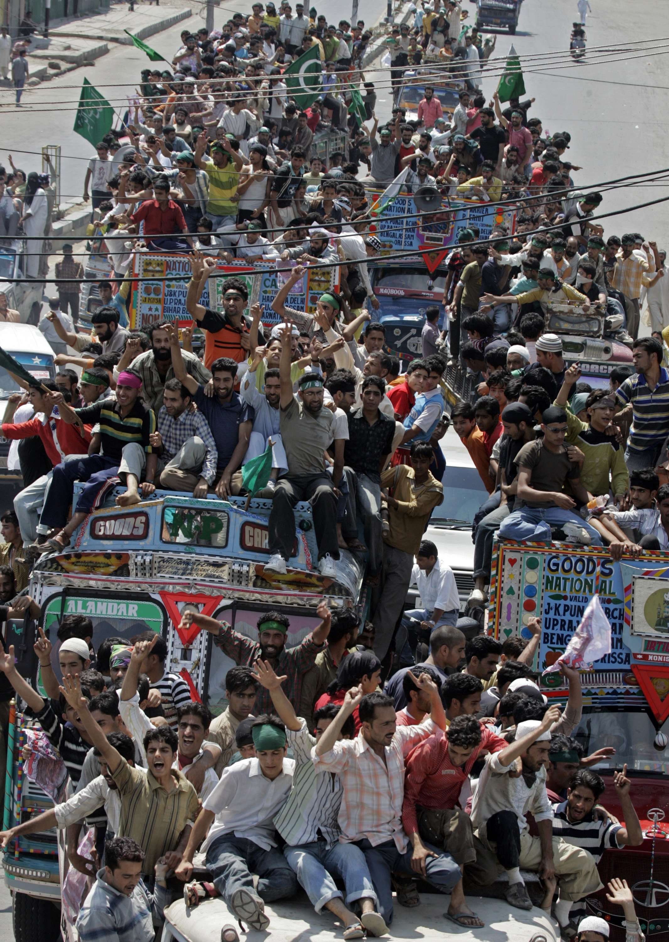 Kashmiri protesters on trucks shout pro-freedom slogans during a march to the Eidgah in Srinagar, India yesterday.