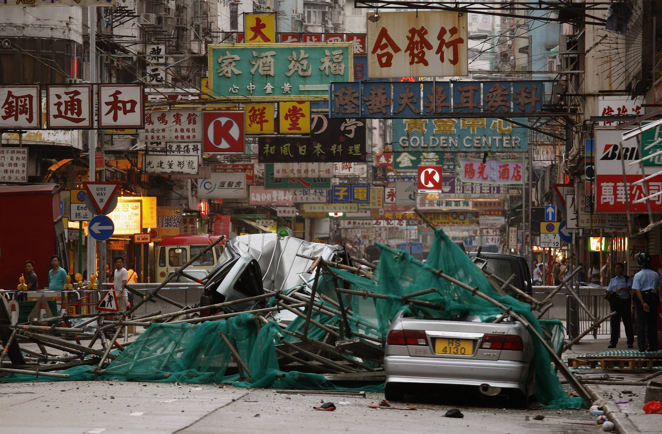 Destroyed vehicles are seen after the scaffolding of a building still under construction collapsed due to typhoon Nuri, in which two people were injur...