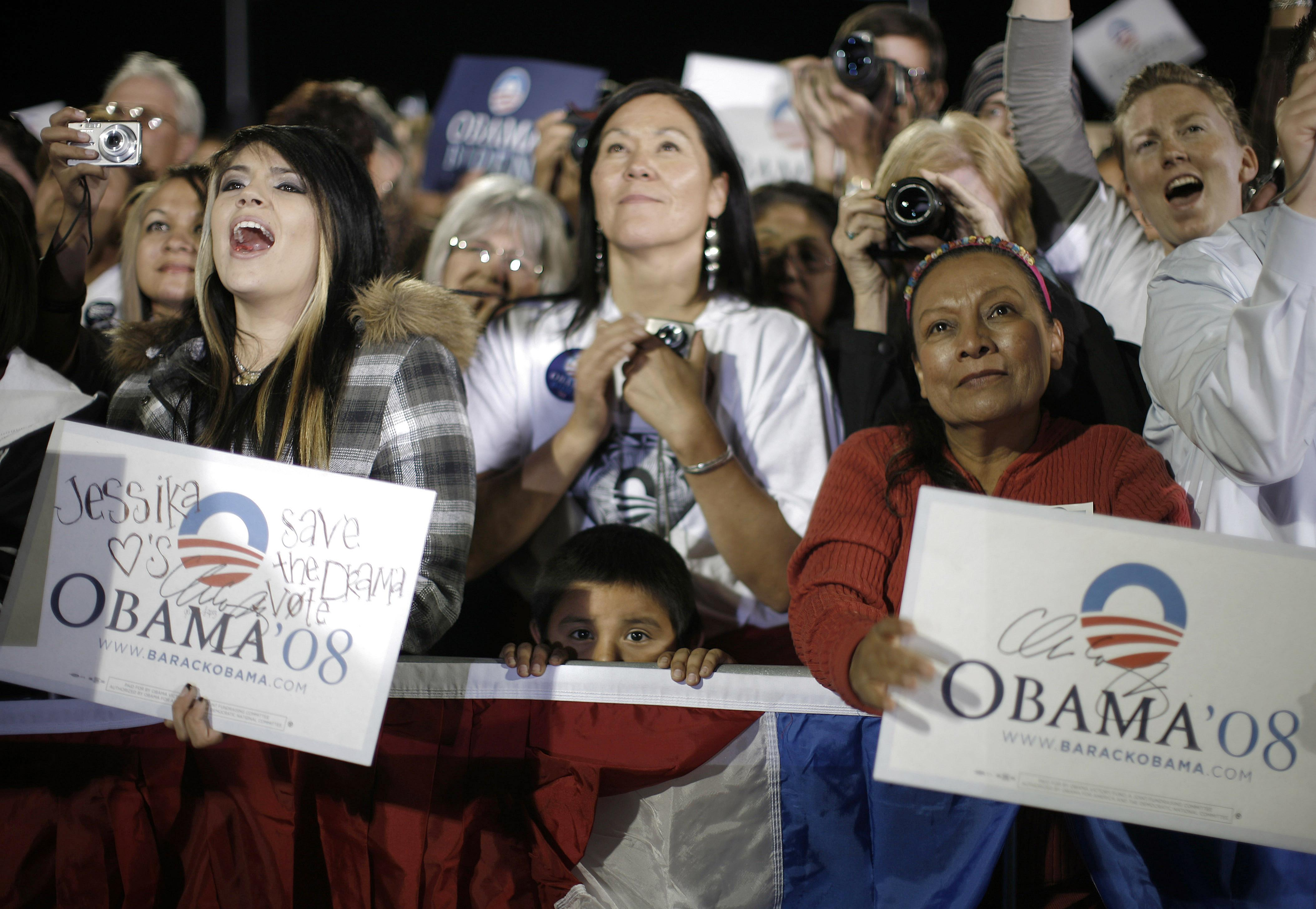 A hispanic boy peeps over the barricade as U.S. Democratic party Presidential nominee Barack Obama speaks during a campaign rally in Albuquerque, New ...