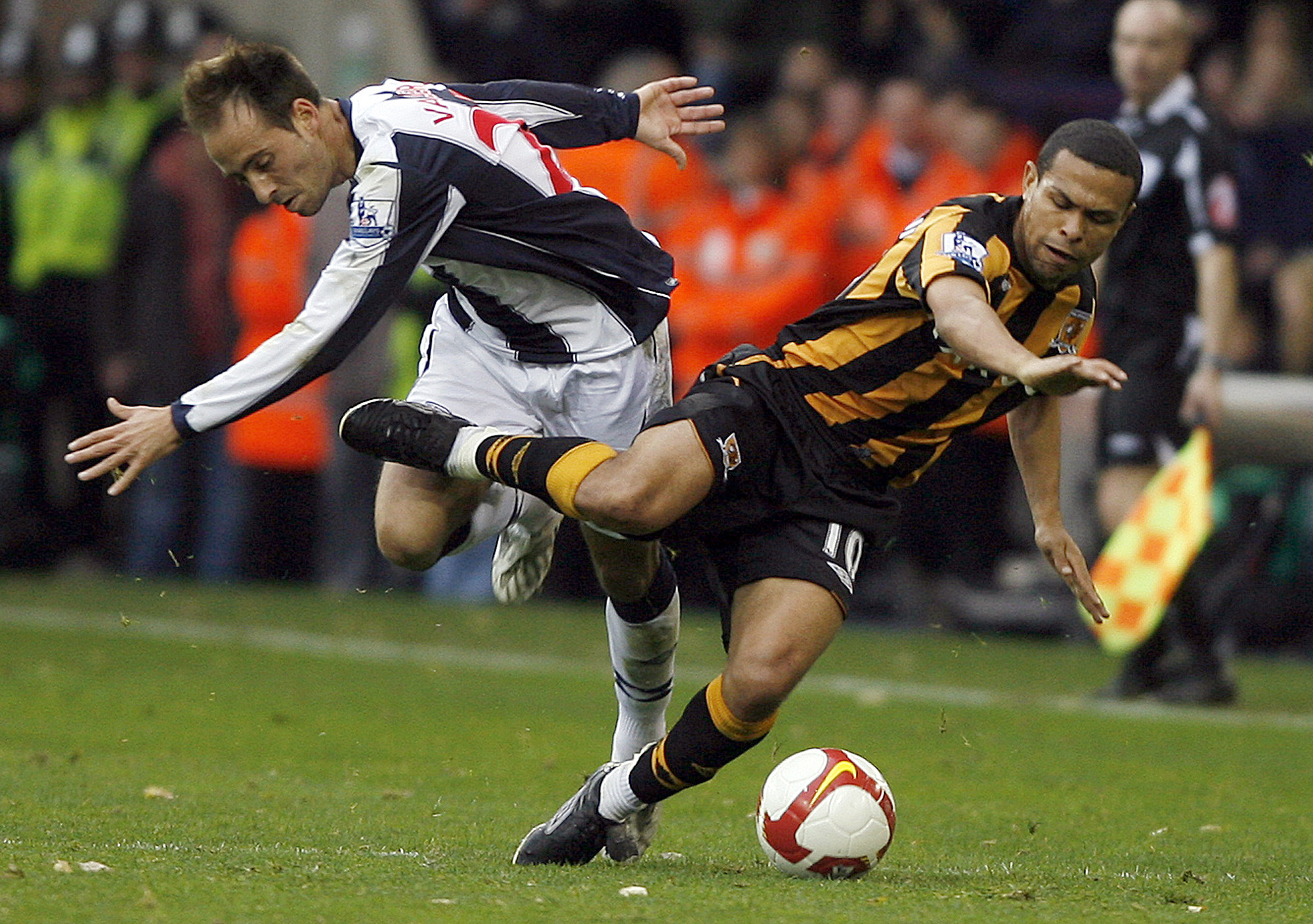 Hull City's Brazilian midfielder Geovanni, right, is fouled by West Bromwich Albion's Valero at the Hawthorns stadium, West Bromwich, England on Satur...