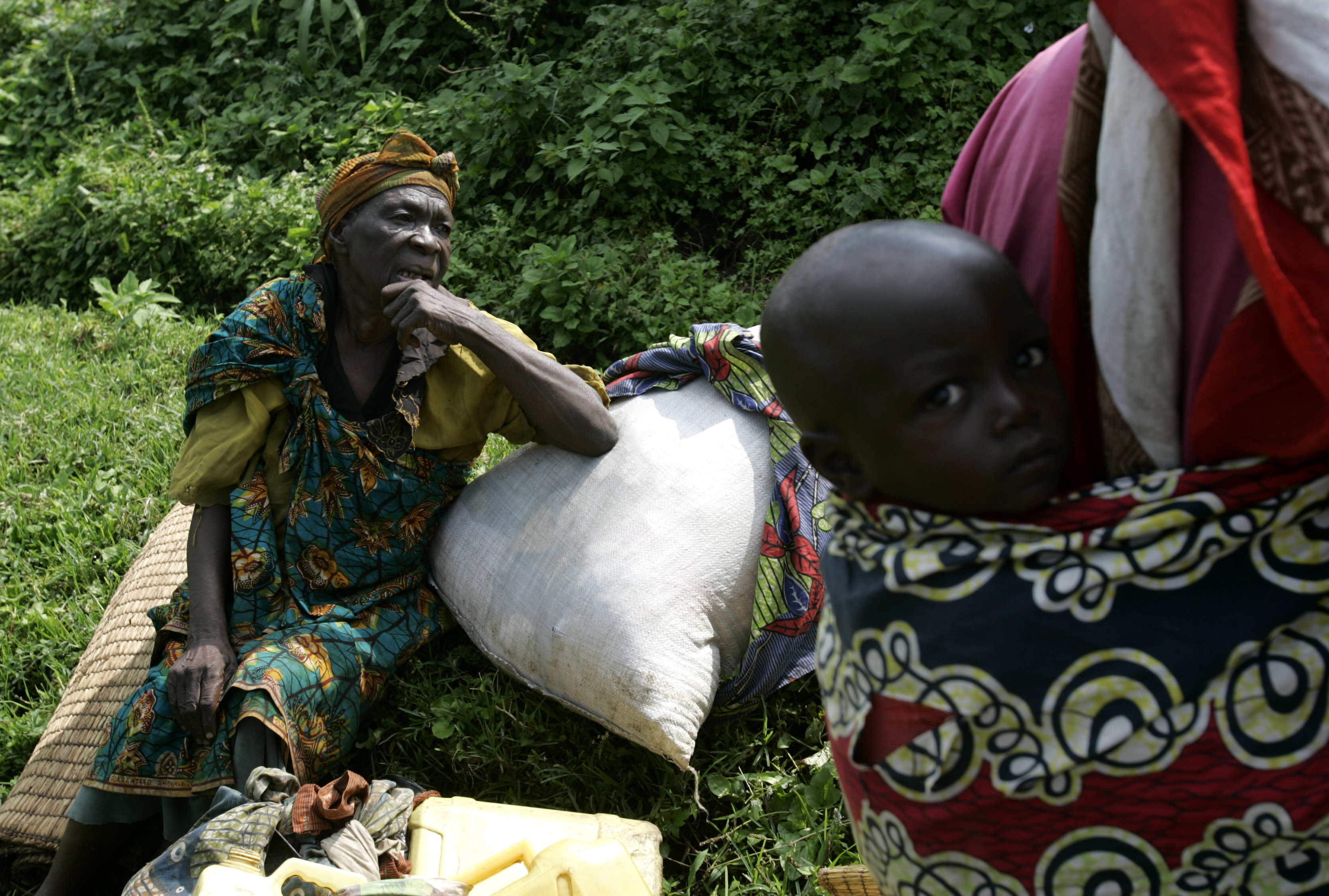 A woman rests next to the road as she flees fighting near Kibumba some 40km north of Goma in eastern Congo yesterday.