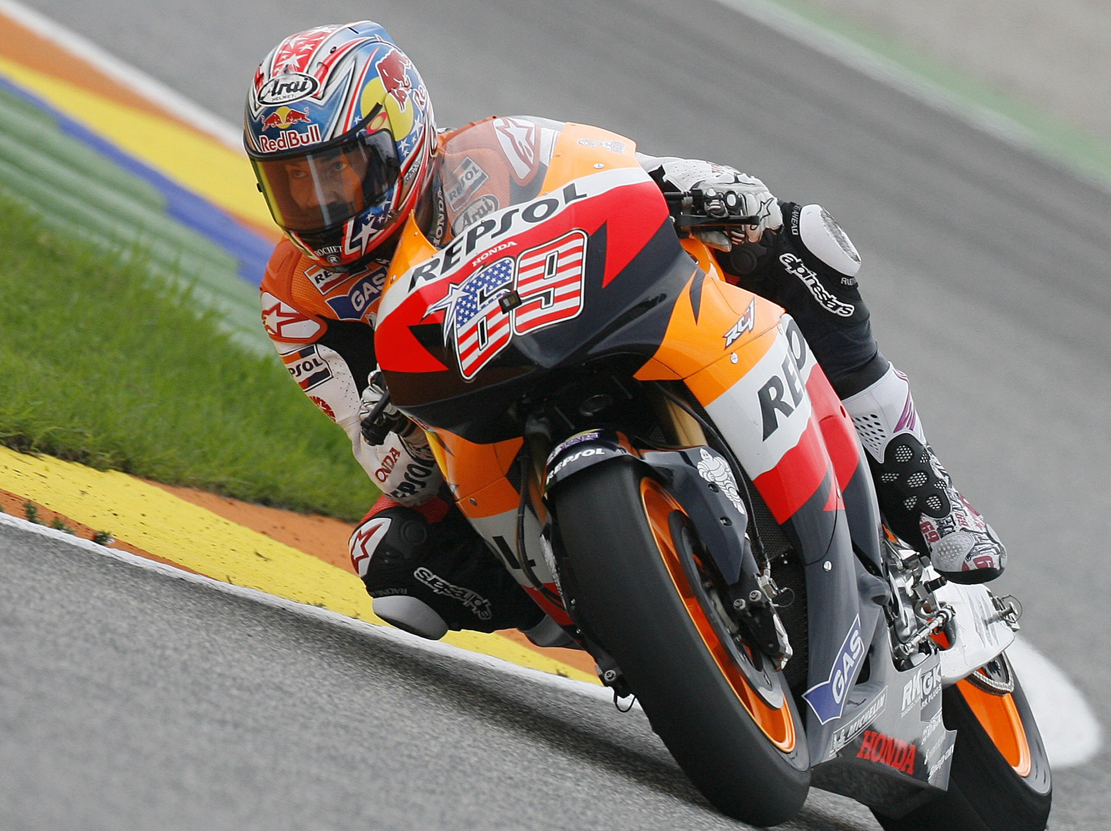 Honda MotoGP rider Nicky Hayden of the U.S. powers through a curve during a free practice session a day before the Valencia Grand Prix at the Ricardo ...