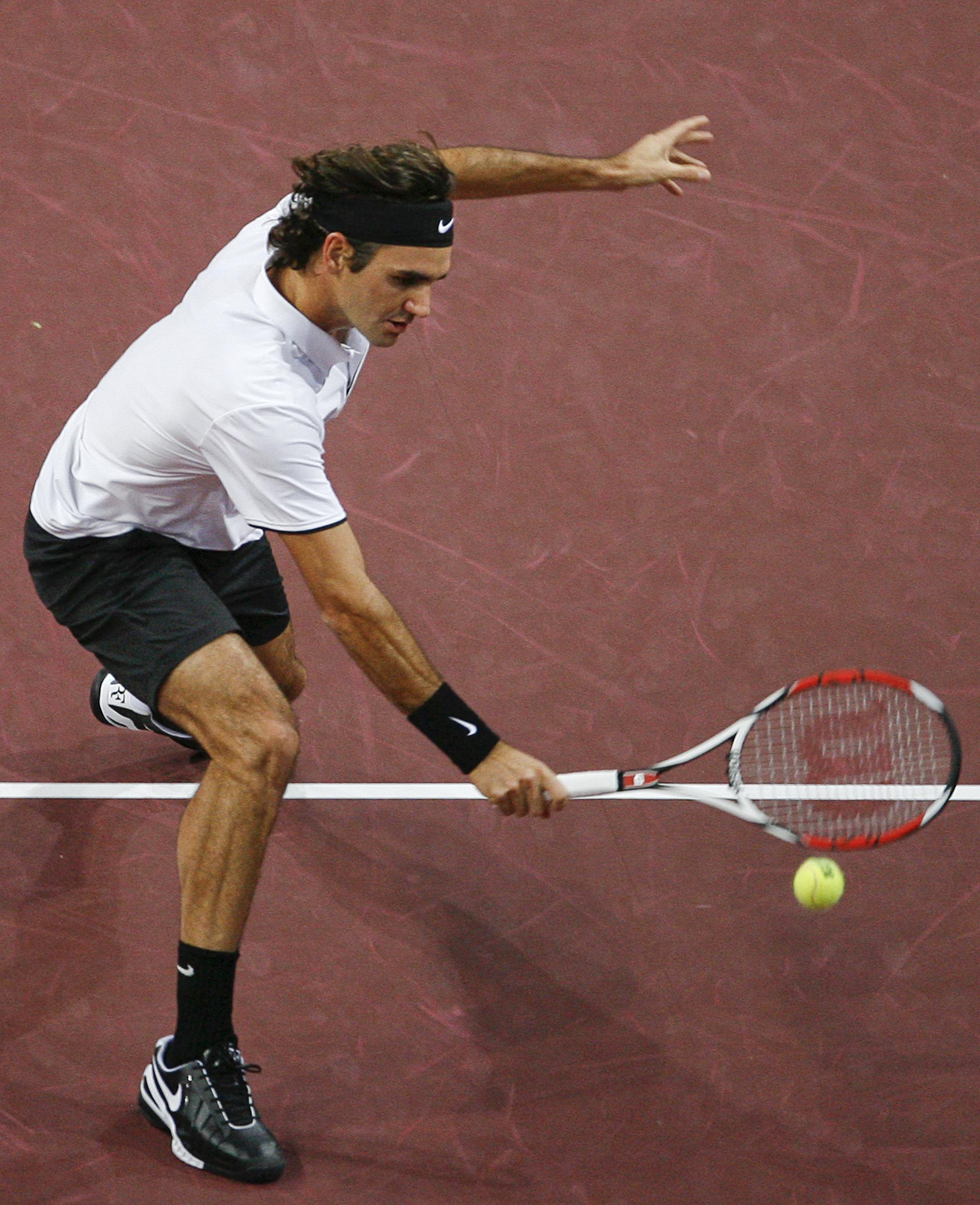 Switzerland's Roger Federer serves to Argentina's David Nalbandian during their final match at the Swiss Indoors ATP tennis tournament in Basel, Switz...
