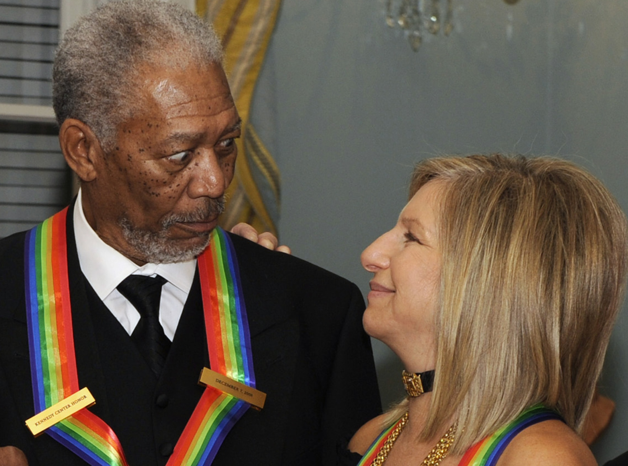Kennedy Center Honoree actor Morgan Freeman looks at fellow honoree Barbara Streisand as they pose for a photograph after receiving their honors at a ...