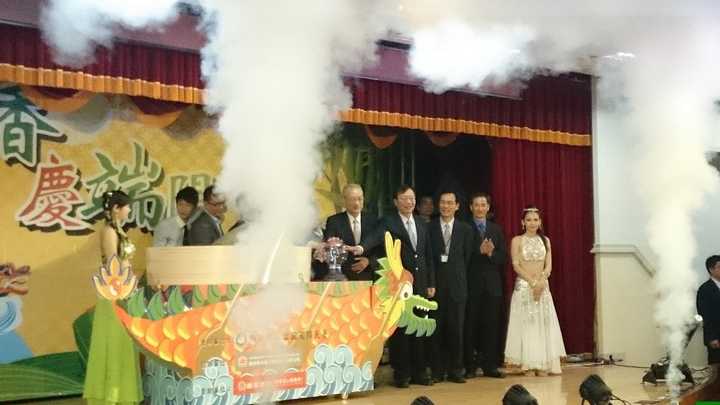 Photo shows the honored guests with the huge rice dumpling.