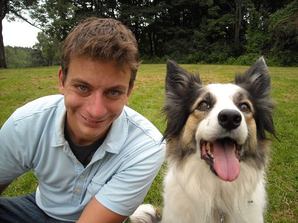 Pet trainer Zac George from the series, 'SuperFetch,' is seen posing with his border collie Venus in this undated photo released by Animal Planet.