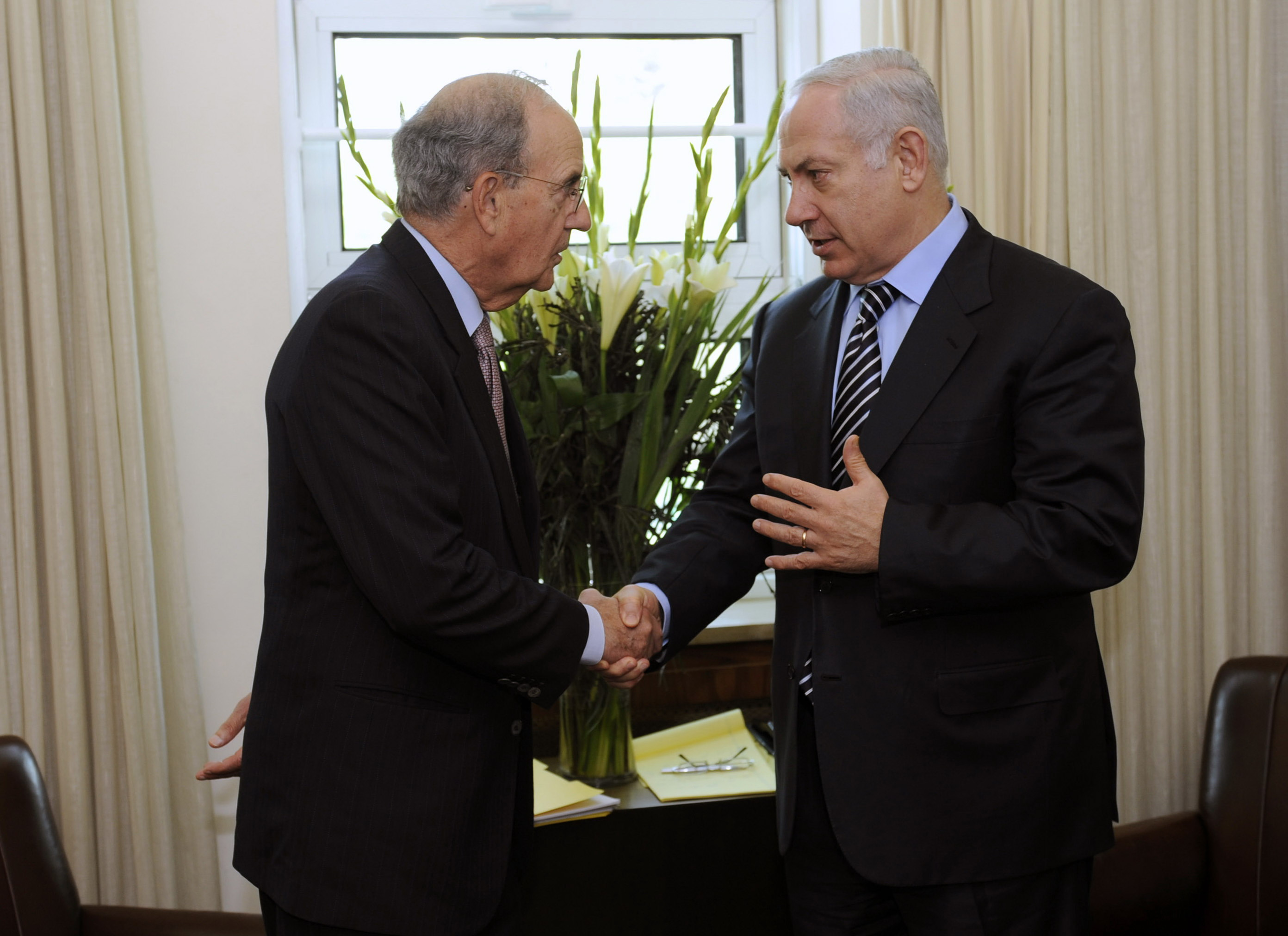 In this photo released by the U.S. Embassy in Tel Aviv, Israeli Prime Minister Benjamin Netanyahu, right, meets with U.S. Mideast envoy George Mitchel...