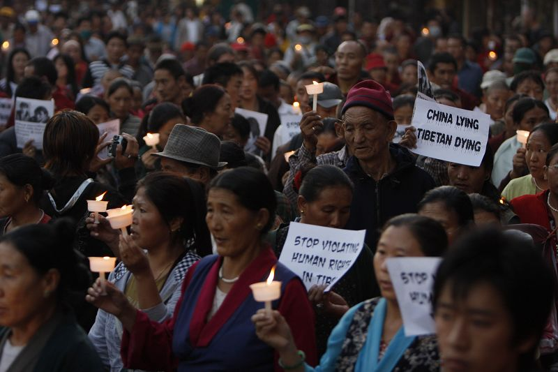 Tibetan exiles participate in a candle light vigil rally to protest against the Chinese government at Baudhanath Stupa in Katmandu, Nepal on Monday. E...