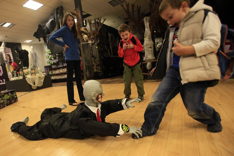 Children play with the Halloween display at the Spirit Halloween store, on Oct. 13 in New York, New York.