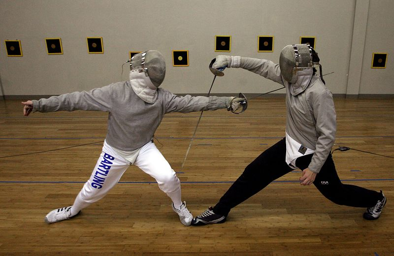 Adam Bartling (left) goes up against Tom Davis (right) at the Olympia Fencing Academy in University City, Missouri, on October 6, 2009.