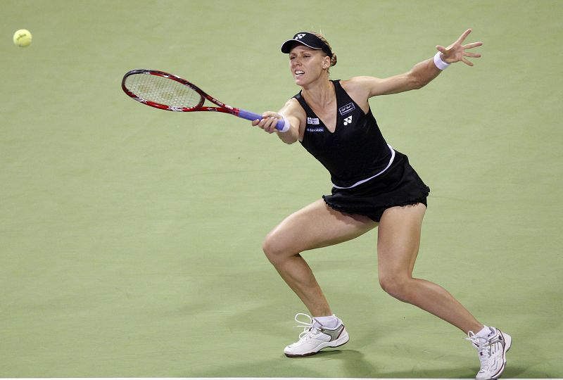 Elena Dementieva of Russia returns a ball to Venus Williams of U.S. during their singles match at the WTA Tennis Championships, in Doha, Qatar on Tues...