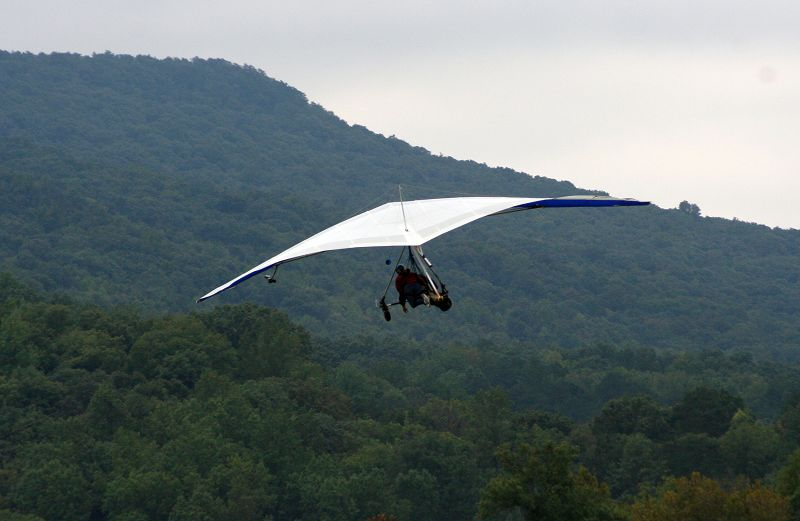 The hang glider looks much like an oversized kite as Mary Ann Anderson and instructor Eric Graper soar high above the valleys of Lookout Mountain.
