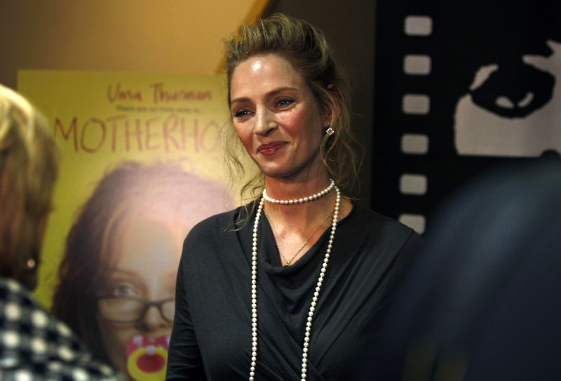 """Uma Thurman arrives on the red carpet for a screening of her film """"Motherhood"""" at the Chicago International Film Festival in Chicago, Illinois on Oct...."""
