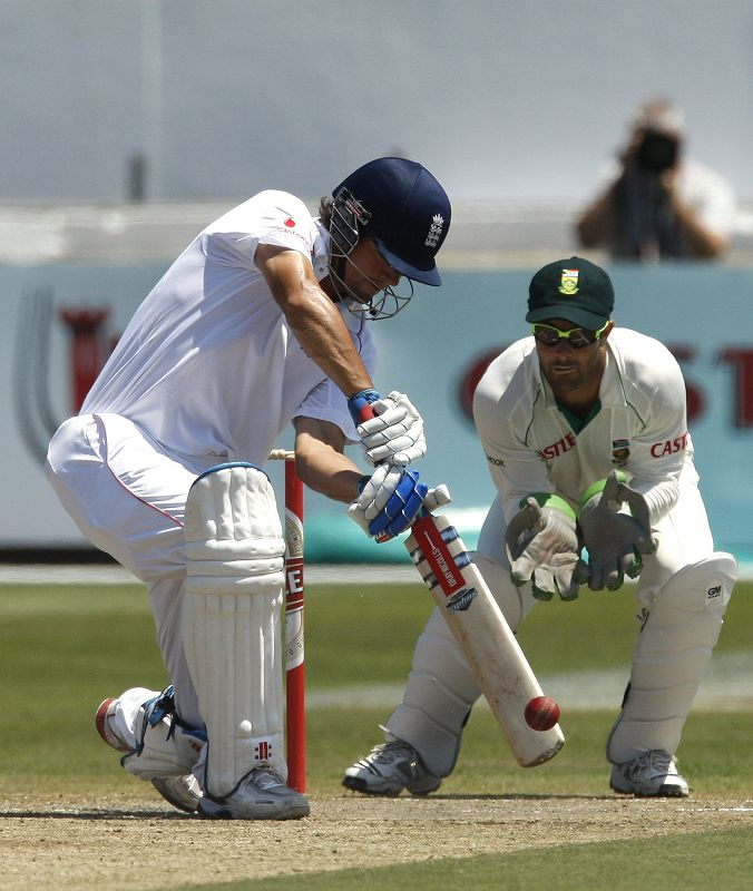 England's batsman Alastair Cook, left, plays a shot as South Africa's wicketkeepr Mark Boucher, right, looks on during the third day of the second Tes...