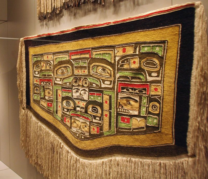 The Chilkat robe on display is unusual in its use of green, red and pink, in addition to the traditional colors of white, black and yellow in the new ...