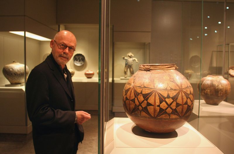 Curator Gaylord Torrence stands next to a Southwest jar, dating from 1770, in the new American Indian galleries at the Nelson-Atkins Museum of Art in ...
