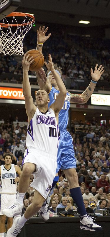 Sacramento Kings' Sergio Rodriguez (10) heads for the basket as Denver Nuggets' Chris Andersen tries to stop him in the second half of an NBA basketba...