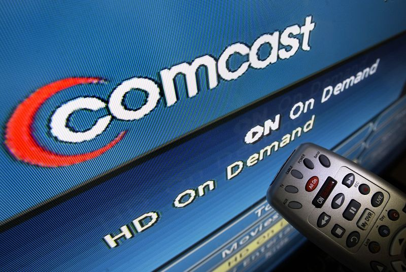 The Comcast logo is displayed on a TV set in North Andover, Massachusetts on Aug. 6. As the nation's biggest pay-TV provider, Comcast Corp., prepares ...