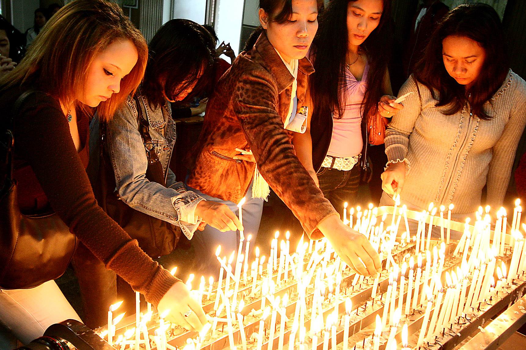 Worshippers put on candles at the St. Christopher's Church, December 24, 2006.