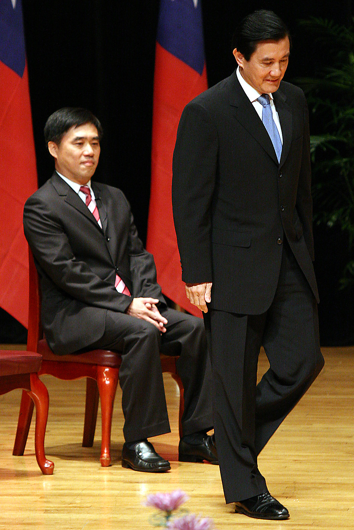 Former Taipei mayor Ma Ying-jeou, right, walks to the stage to make his farewell speech as the new mayor Hau Lung-bin looks on at the inauguration cer...