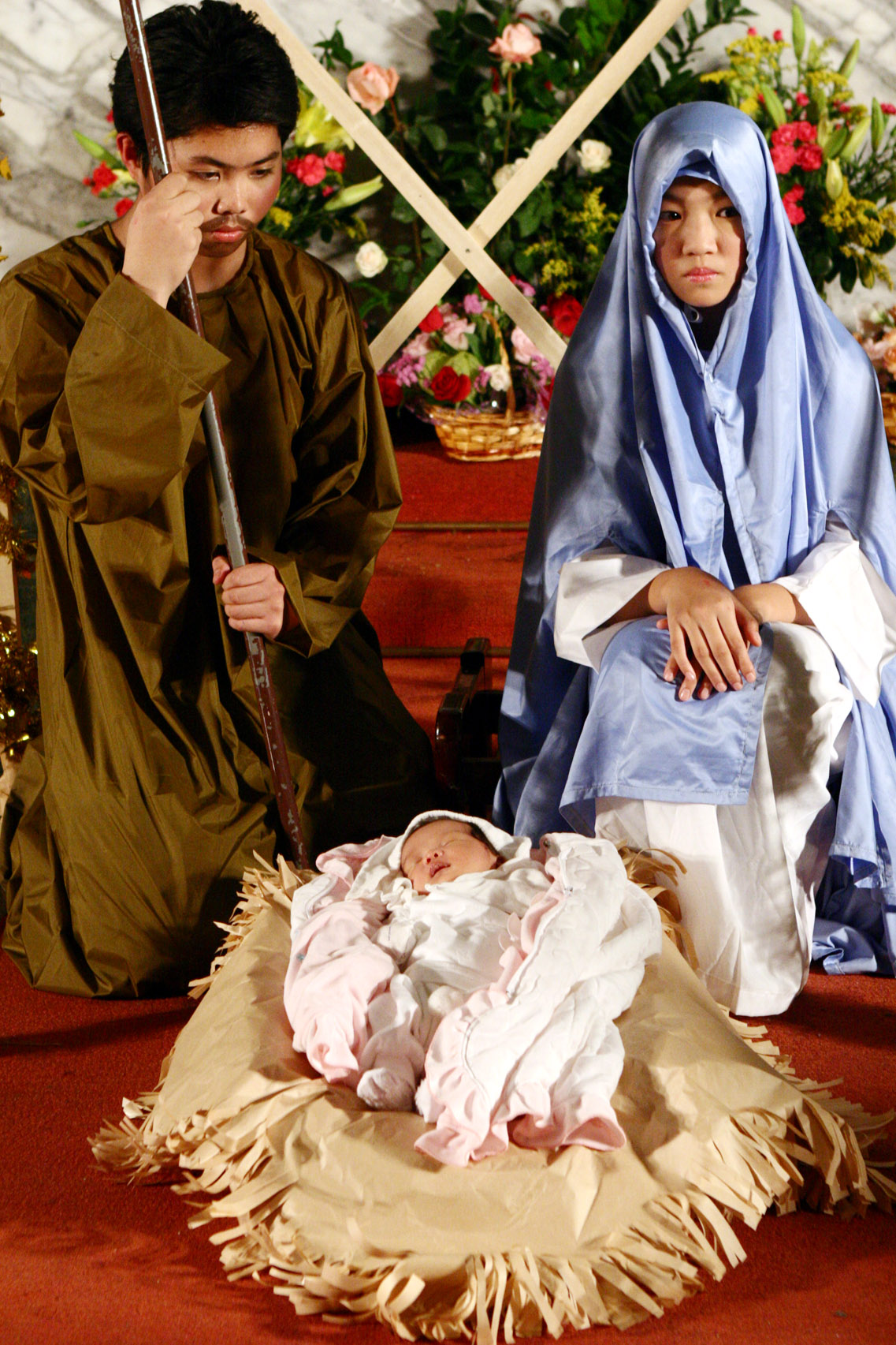 Children in costume perform a nativity scene as they celebrate Christmas at St. Christopher's Church in Taipei, December 24, 2006.