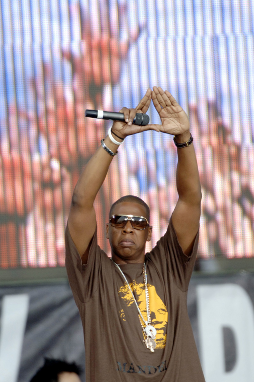 Rapper Jay-Z acknowledges the crowd  during the Live 8 concert in Philadelphia, Pennsyvania in July 2005.