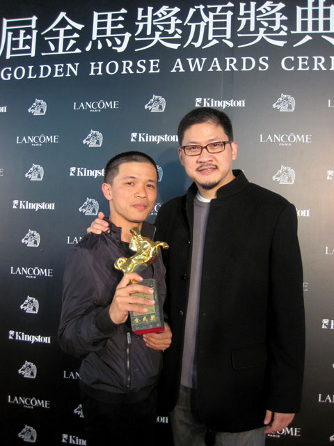 Su Che-hsien, left, director of Hip-Hop Storm, holds the trophy of the 2010 Golden Horse Award for Best Documentary with Ben Tsiang, CEO of CNEX.  Ph...
