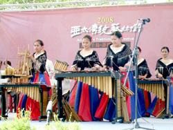 The Banda Kawayan musicians, wearing Maria Clara dresses, play lively music on bamboo instruments. / Central News Agency / Nancy T. Lu, Taiwan News