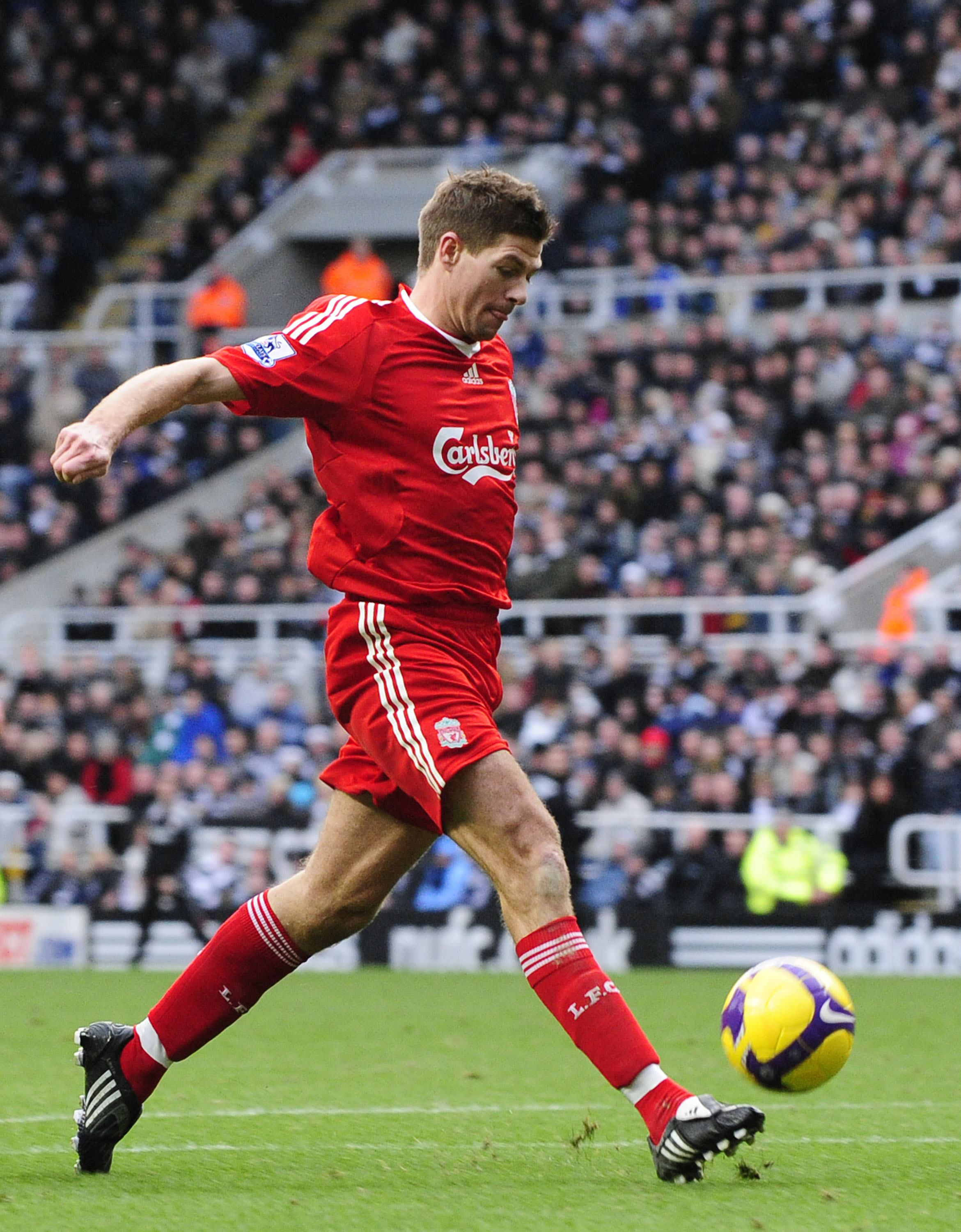 Liverpool's Steven Gerrard shoots to score in Newcastle, England on Sunday.