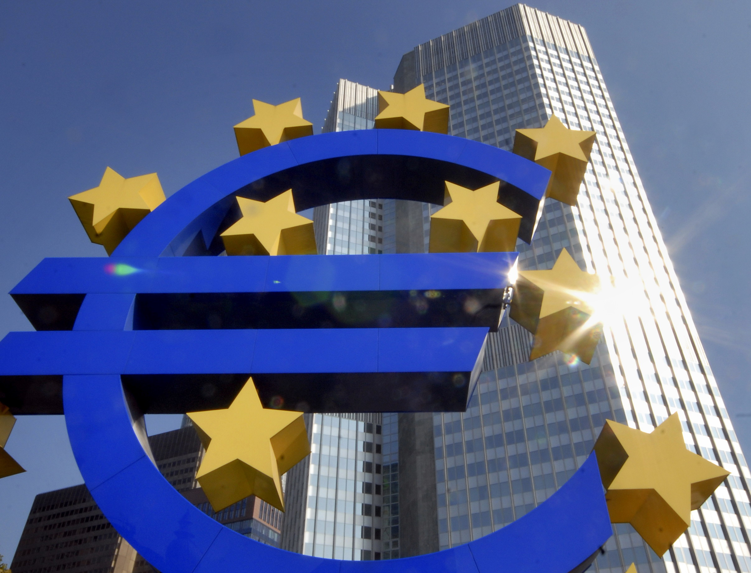 In this September 2007 file picture, the Euro sculpture, the autumnal sun, is seen in front of the European Central Bank building in Frankfurt, German...