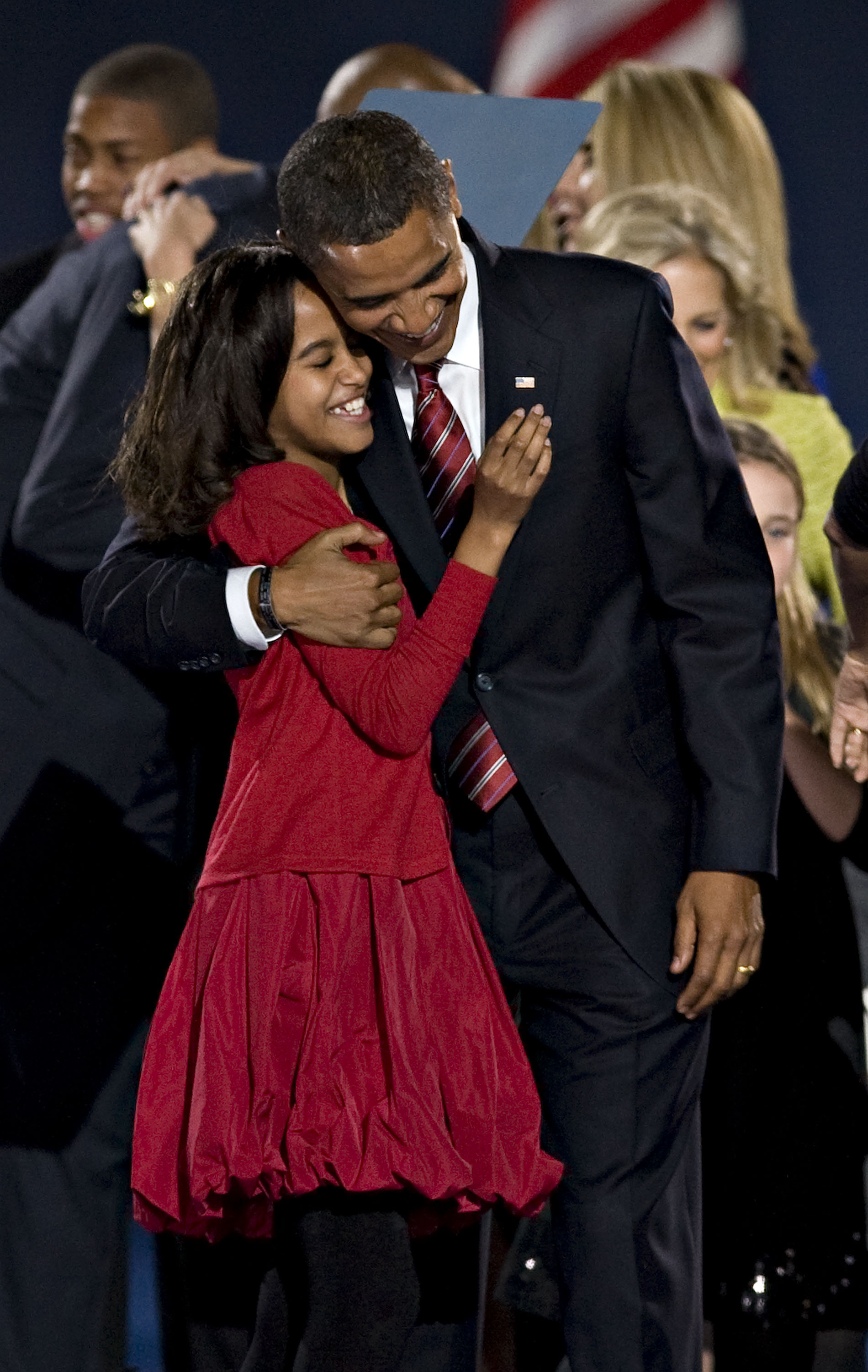 Barack Obama embraces his eldest daughter Malia Ann after delivering his acceptance speech during an election night rally in Grant Park in Chicago, Il...
