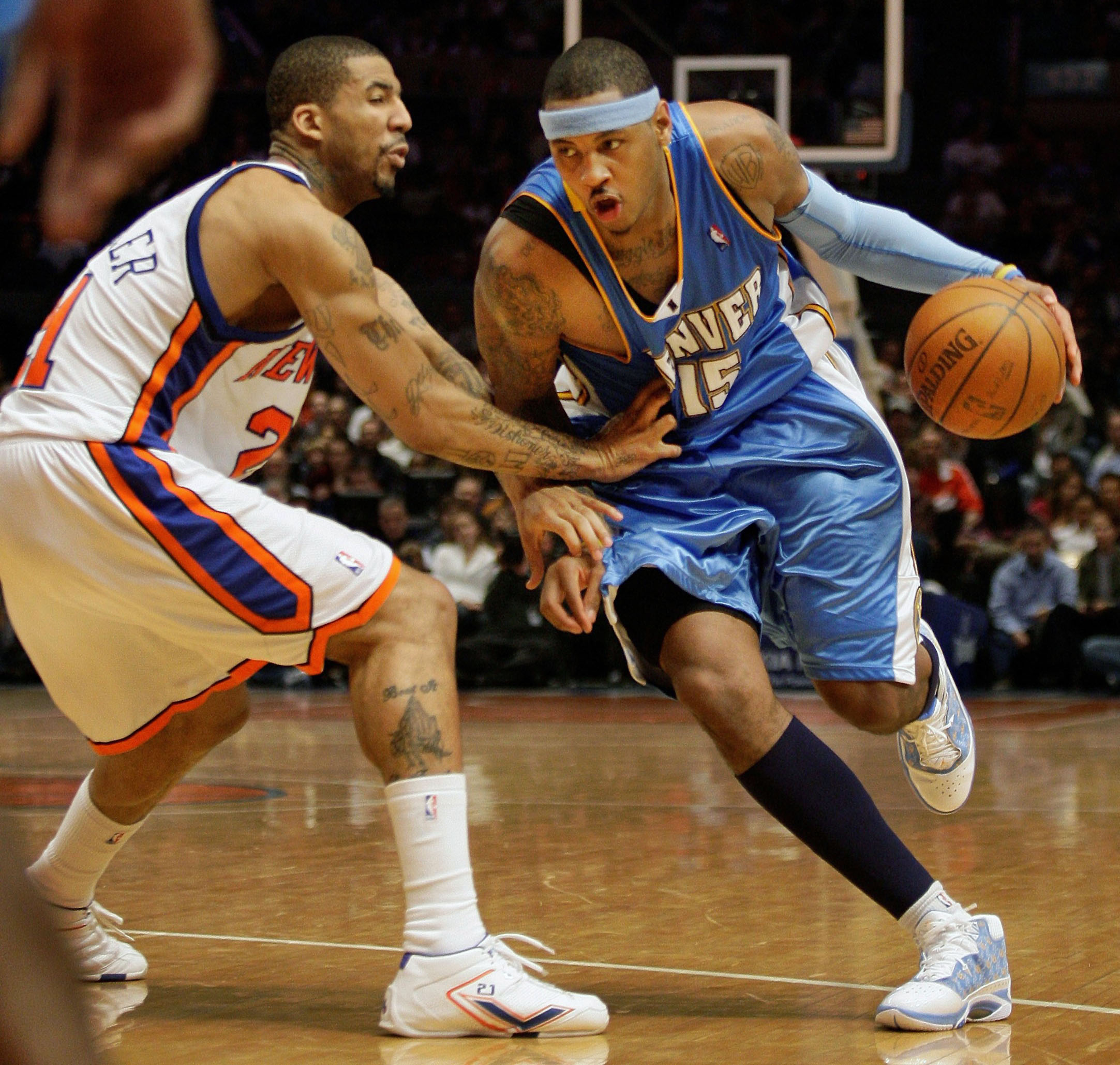 Denver Nuggets forward Carmelo Anthony, 15, drives past New York Knicks forward Wilson Chandler, left, in the fourth quarter of the Nuggets' game at M...