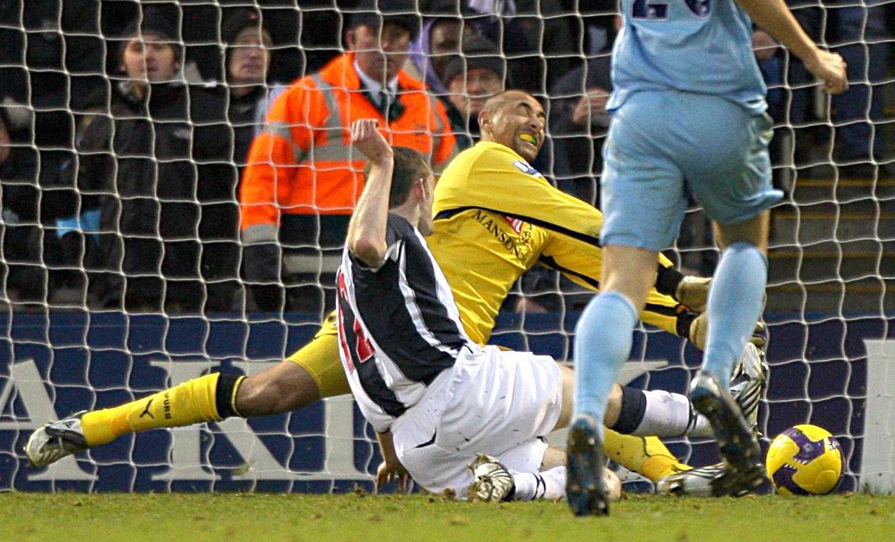 West Bromwich Albion's Craig Beattie, left, scores past Tottenham Hotspur goalkeeper Heurelho Gomes in West Bromwich, England on Sunday.