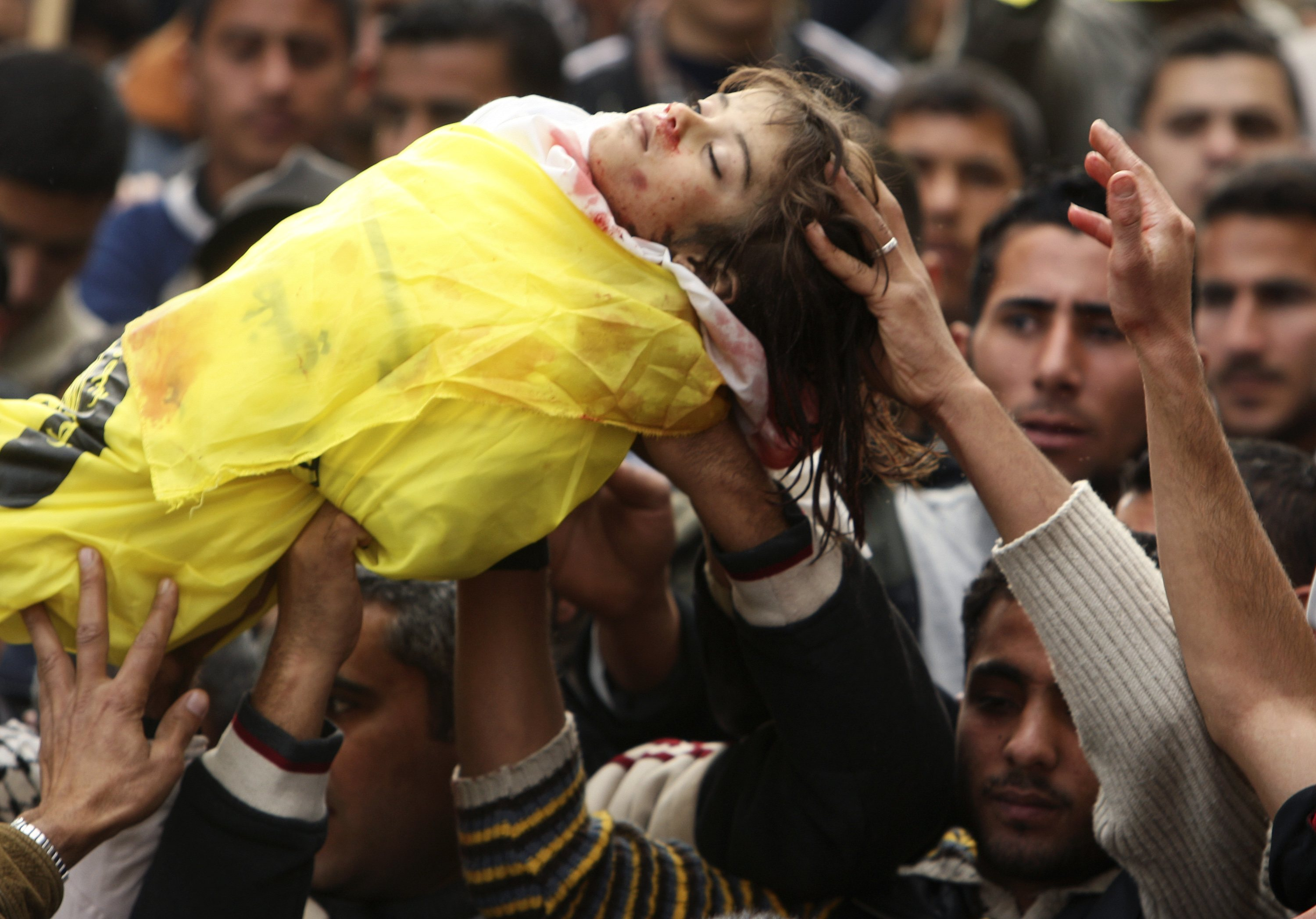 Palestinians carry the body of 4-year-old Lama Hamdan during her funeral in the town of Beit Hanoun in the northern Gaza Strip yesterday. In Beit Hano...