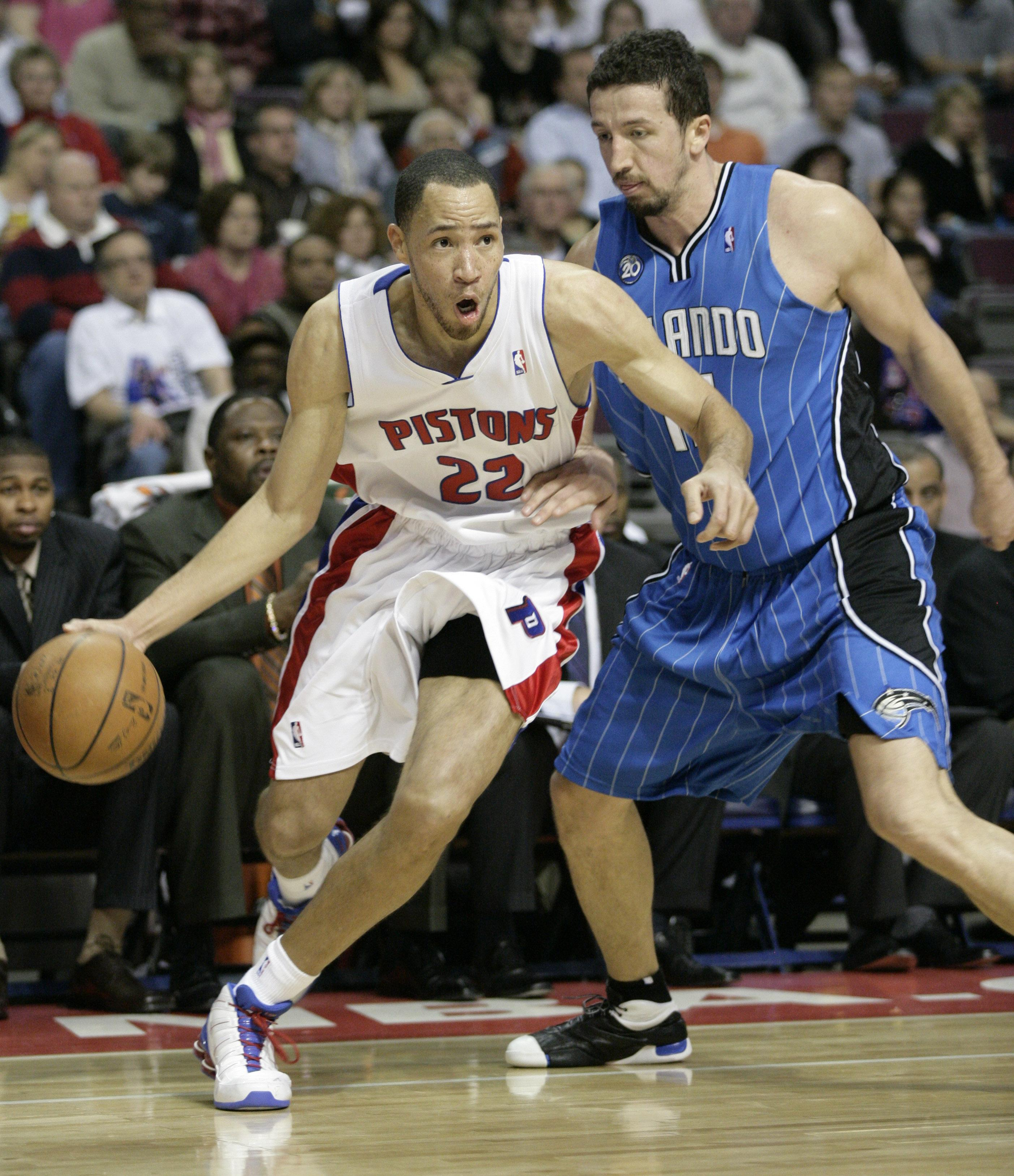 Detroit Pistons forward Tayshaun Prince, left, drives to the basket against Orlando Magic forward Hedo Turkoglu, of Turkey, in the second half of an N...