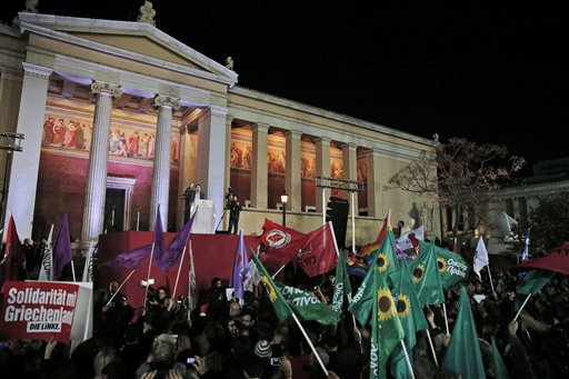 Leader of Syriza left-wing party Alexis Tsipras speaks to his supporters outside Athens University Headquarters in Athens, Sunday, Jan. 25, 2015. A tr...