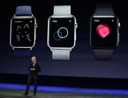 Apple CEO Tim Cook talks about the new Apple Watch during an Apple event on Monday, March 9, 2015, in San Francisco.  Starts at $349 with Apple Watc...