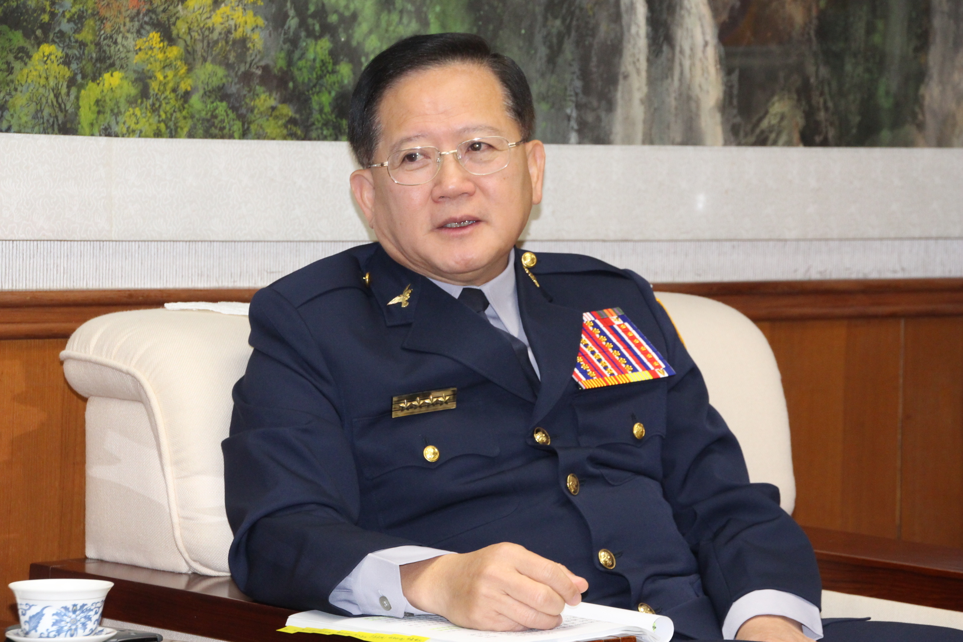 Chen Guo-En, an avant-garde police director general