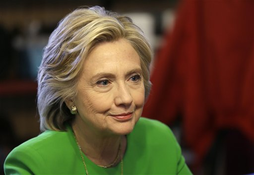 IN this April 14, 2015, photo, Democratic presidential candidate Hillary Rodham Clinton meets with local residents at the Jones St. Java House in LeCl...