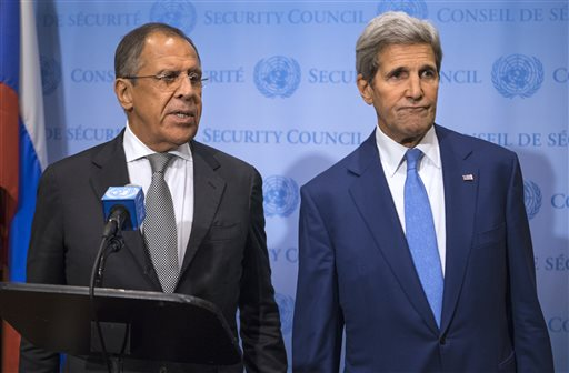 Russia's Foreign Minister Sergey Lavrov, left, speaks during a news conference next to U.S. Secretary of State John Kerry at the U.N., Wednesday, Sept...