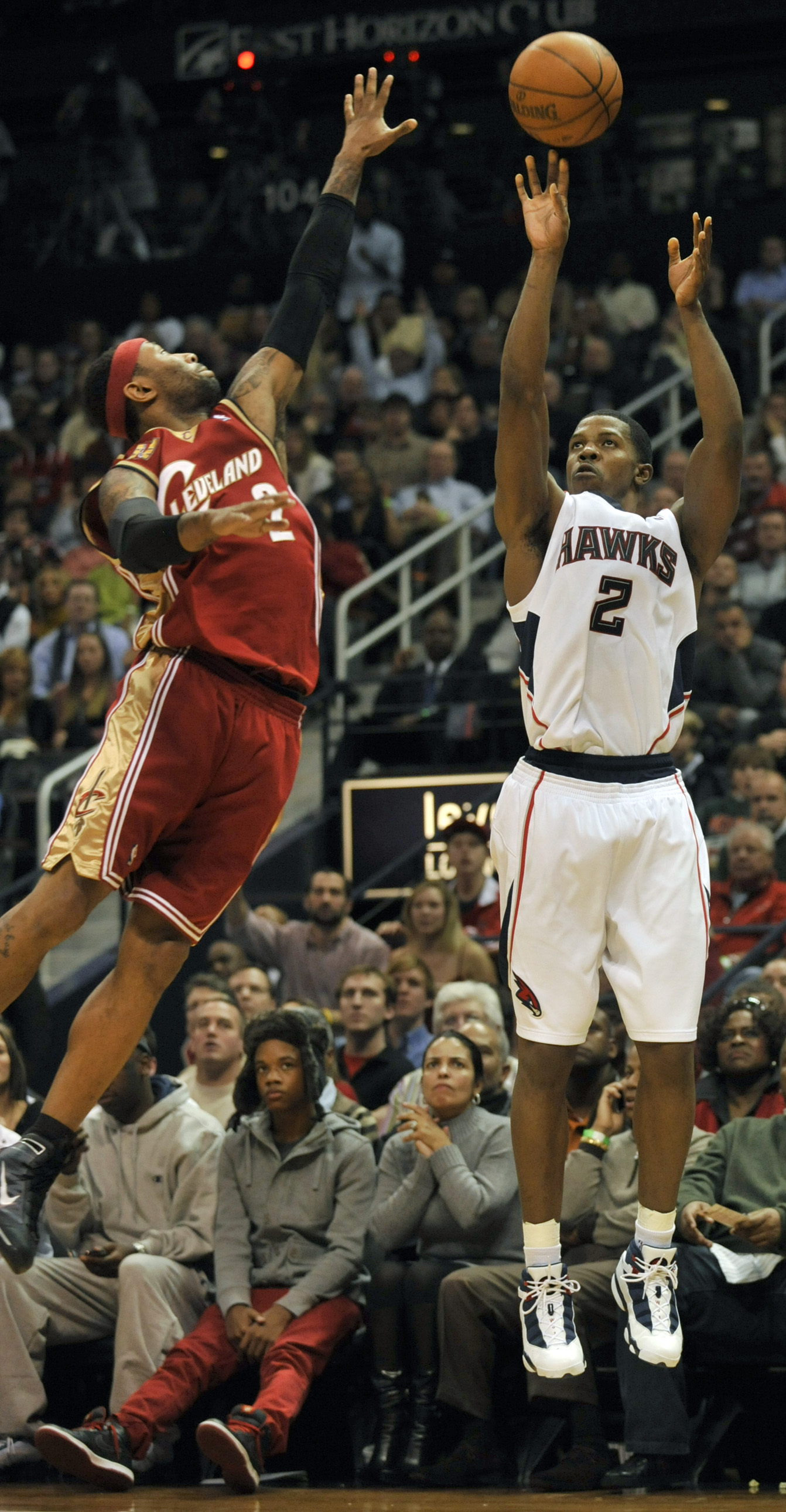 Atlanta Hawks guard Joe Johnson (2) takes a shot against Cleveland Cavaliers guard Mo Williams (2) during the fourth quarter of an NBA basketball game...