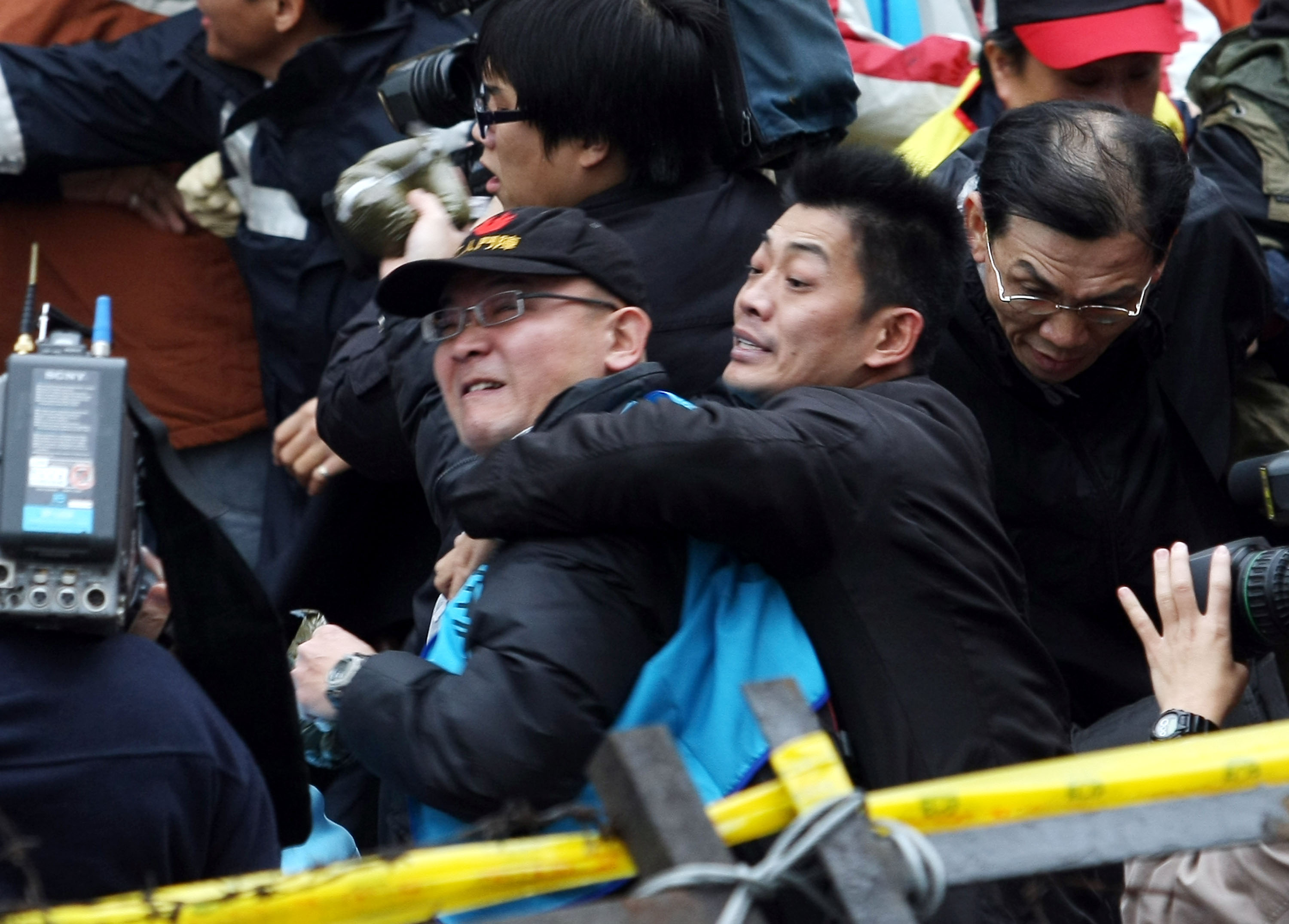 Anger takes over as Labor unions protesters from all over Taiwan threw cow dung at the building of Kuomintang headquarters in Taipei yesterday to oppo...