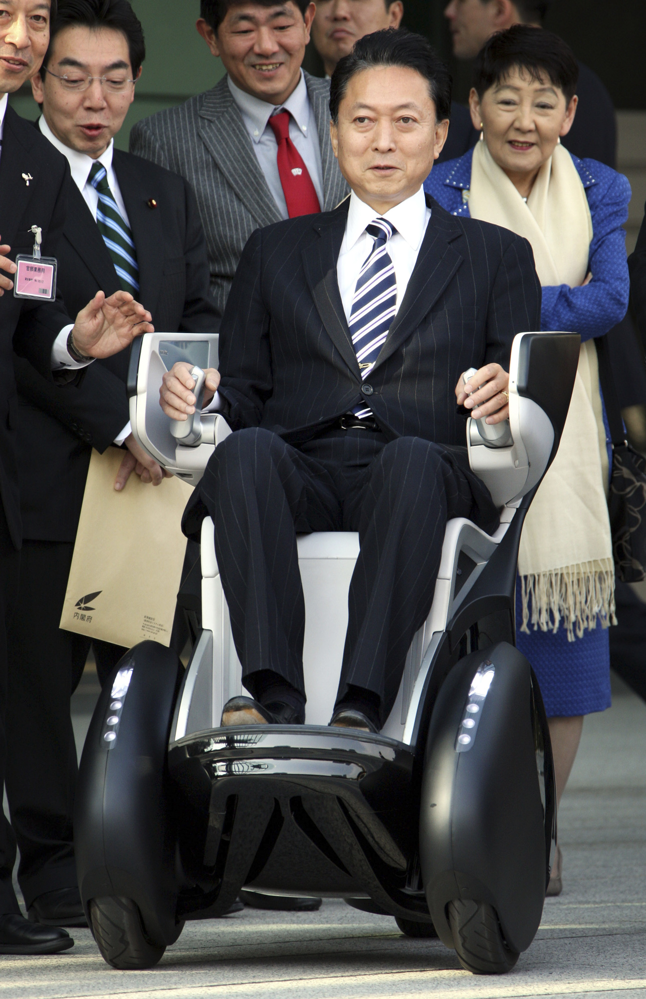 Japan's Prime Minister Yukio Hatoyama tries on a Toyota's personal mobility vehicle 剫-REAL' as part of demonstration to promote green economy at the P...