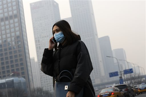 """Officials in Beijing declared Monday evening the smog """"red alert,"""" referring to the highest warning level on the air pollution monitor."""