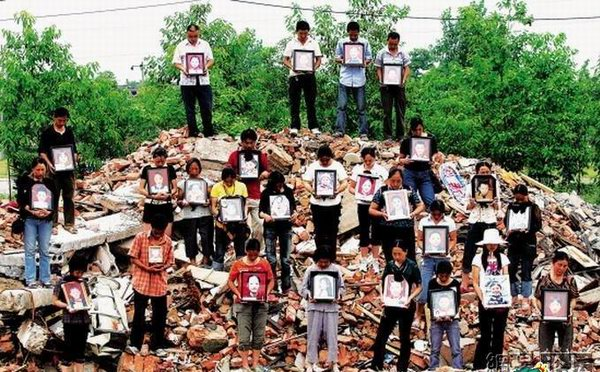 From Who Killed Our Children released in 2008, a group of parents holds pictures of their children killed in the 2008 Sichuan earthquake. (Photo Court...