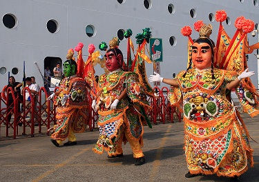 The Chinese diety San Tai Tzu perform in front of a group of more than 1,200 Chinese tourists who arrived in Kaohsiung today aboard a cruise liner nam...