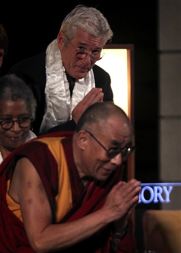 Actor Richard Gere, top, and author Alice Walker, left, look on as The Dalai Lama acknowledges the audience after speaking at Emory University Tuesday...