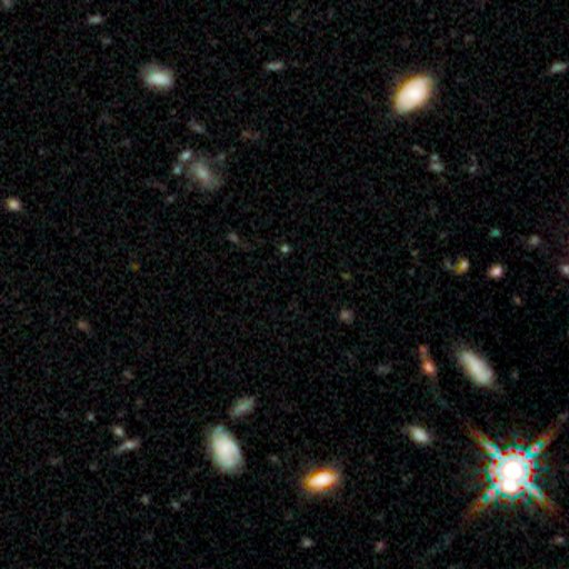 The center of this Jan. 5 NASA handout image, taken by the Hubble Space Telescope, is a hard-to-see galaxy that European astronomers say is the oldest...